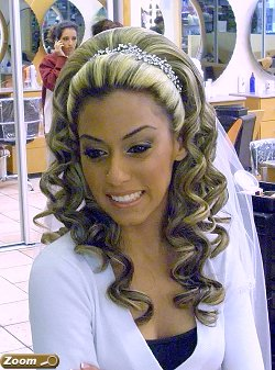 The bride and her bridesmaids all get a great hair style at Raphael International